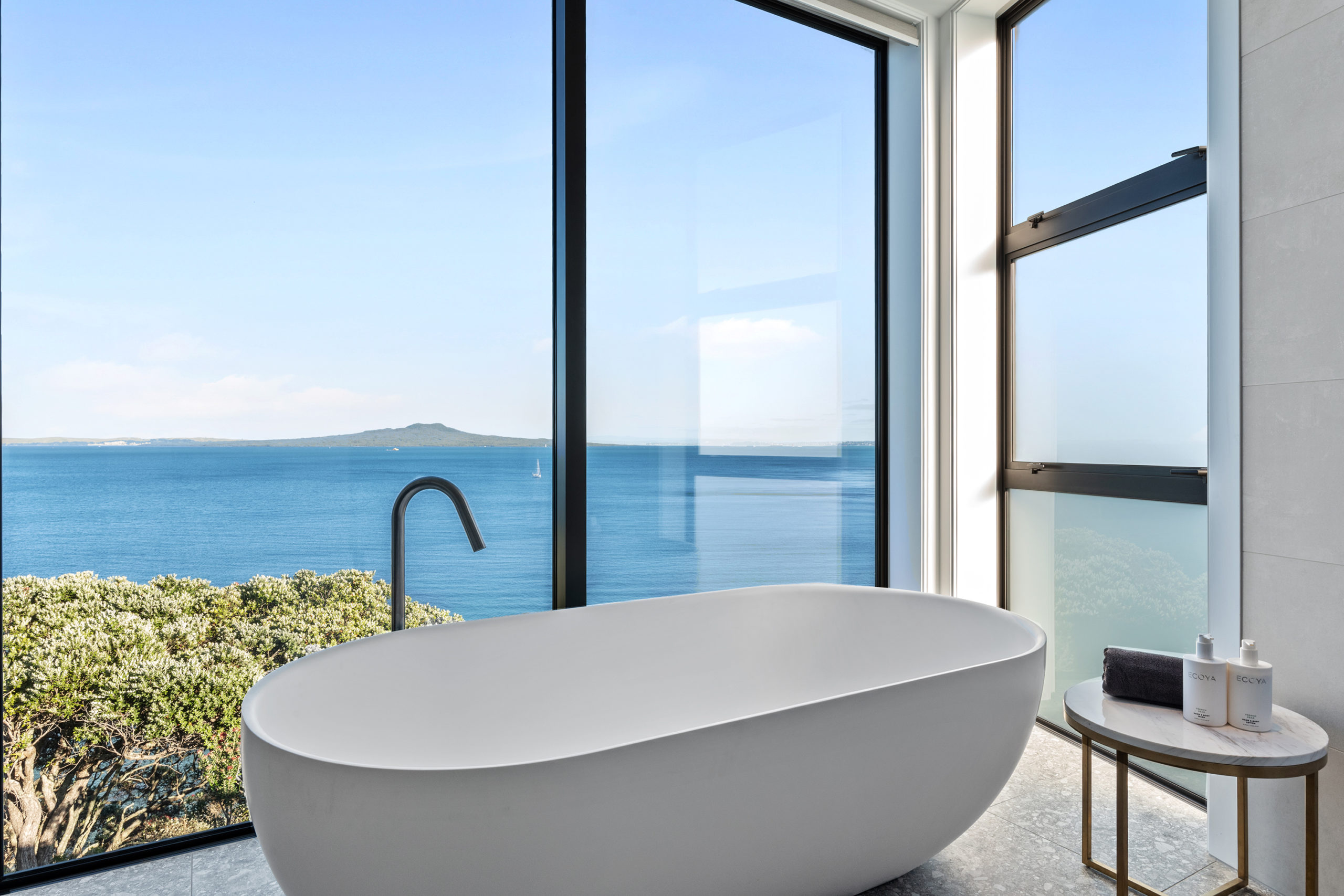 Starke 40mm architectural aluminium joinery, showing bath and view of rangitoto